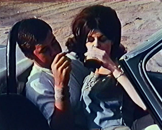 Kissing Couple in Manos: The Hands of Fate