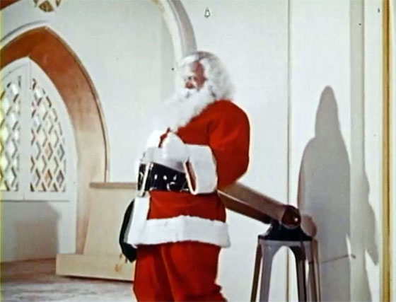 Santa Claus tries vibrating belt machine