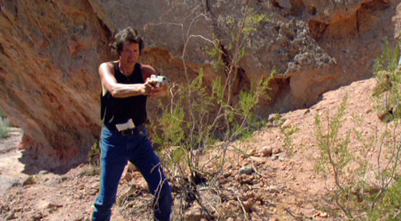 Neil Breen looks funny with his toy guns.